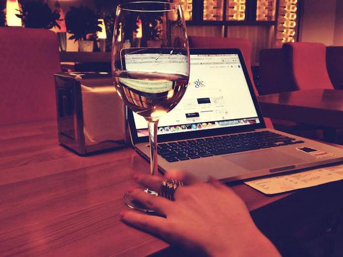wine and laptop web browsing